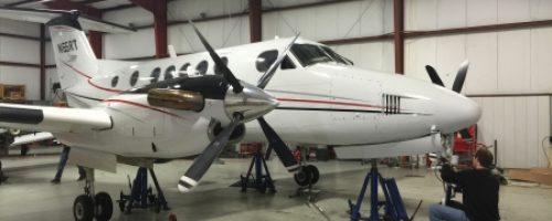 mechanic-working-on-King-Air-450x300